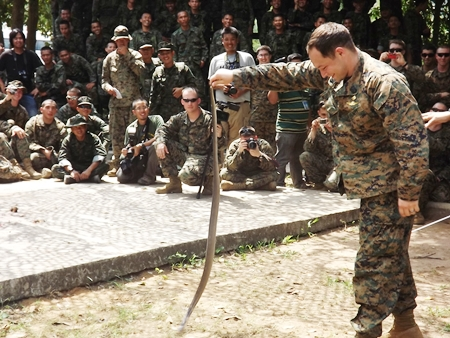 US troops are given a chance to try their hands at capturing a live cobra.