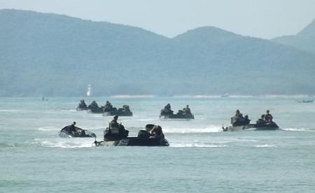 Amphibious vehicles bring troops ashore in Sattahip.