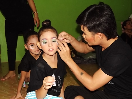 The youngsters' long day begins early in the morning with five hours of makeup, hair styling and body paint.
