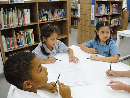 Jennisa's team working on the 'Book Challenge'.