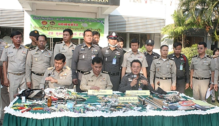 Officers display the cache of drugs, weapons and other paraphernalia confiscated during a search of Pattaya Remand Prison in Nong Plalai.