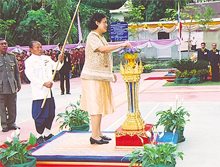 HRH Princess Maha Chakri Sirindhorn pushes the button to officially open the new multi-purpose building at Pattaya Redemptorist Vocational School on February 15, 2007. HRH the Princess then laid the foundation stone for the HRH Princess Maha Chakri Sirindhorn Building at the Pattaya Redemptorist School for the Blind, which is under the patronage of Her Royal Highness. (Photo courtesy Bureau of the Royal Household)