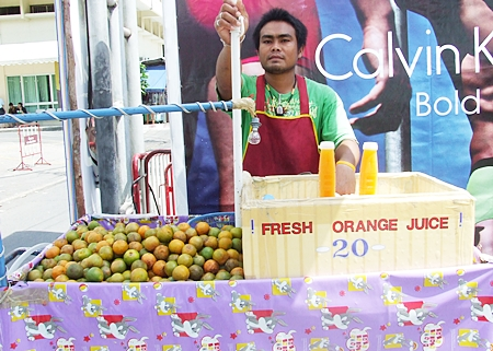 Adisak Chinnok sells freshly squeezed orange juice with only a few additives.