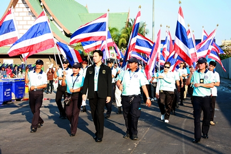 "Mayor Itthiphol Kunplome leads the ""Pattaya Team"" parade, announcing a joint effort to provide better goods, services and security for area residents and visitors."