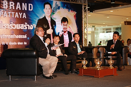 (L to R) Asst. Prof. Thatchai Chuenchom addresses a large group of Pattaya entrepreneurs (not shown) as Thanyawat Chaitrakulchai, Mayor Itthiphol Kunplome and moderator Kamphoo Phurpuwadol listen in.