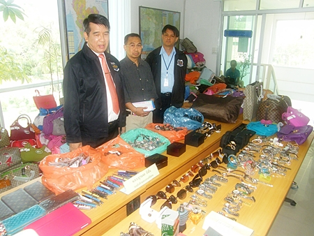 Police lay out for display some of the goods confiscated in what they are billing as the largest ever haul of counterfeit goods on the Eastern Seaboard.