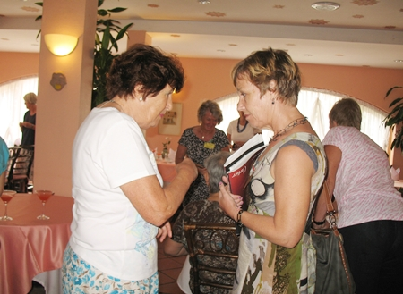 PILC members Angela Proustie and Anja Schoof in deep discussion at the March luncheon.