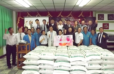 South Korean and Thai Rotarians donate fifty 60-kg bags of rice to the Father Ray Foundation's S.O.S. Rice campaign.