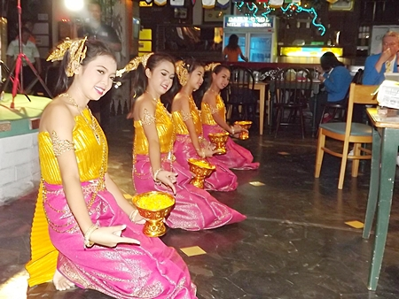 Beautiful Thai dancers give a cultural performance for the guests at the Green Tree Pub.