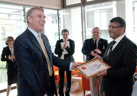 Prince Andrew presents British Ambassador Asif Ahmed with a Friend of the Legion Certificate.