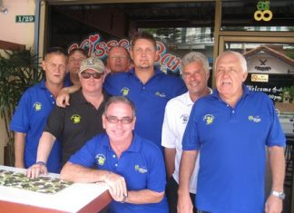 Esteemed members of the Backyard Golf Society pose for a photo outside Kisses Bar.