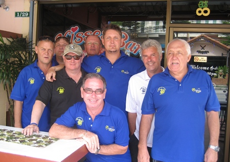 Esteemed members of the Backyard Golf Society pose for a photo outside Kisses Bar.