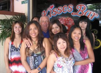 JJ (standing rear) is congratulated on his win by the staff at Kisses Bar.