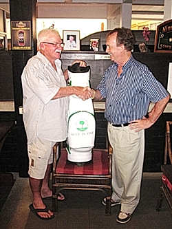 Russell Meiers (left) is all smiles as he accepts his new IPGC golf bag from Stephen Beard of IPGC.