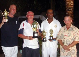 Tournament winners Frank, Dave and Dennis pose for a photo with 'Rolex' (right).