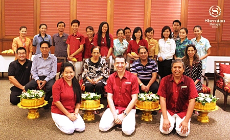 Management, staff and associates of the Sheraton Pattaya Resort participated in the Songkran celebrations to pray and present alms to monks and to gently pour fragrant lustral water adorned with roses and jasmine flowers over the Buddha image. The staff also poured water on the hands of revered elders such as Om Parkash Bajaj, the hotel's owner (second row, left), Michael Delargy, General Manager (centre front) and Rojjana Franzke, Executive Assistant Manager (left front) who in turn gave them their blessings.