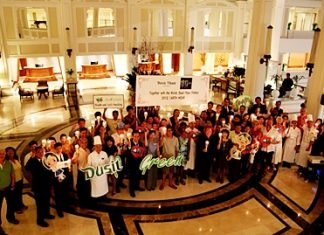 """The management and staff of Dusit Thani Pattaya led by GM Chatchawal Supachayanont are joined by hotel guests in observing Earth Hour 2012 held on Saturday, 31 March at the resort's Main Lobby. This year's campaign was titled """"I Will if You Will"""" and the hotel was one of the millions of homes and business establishments across the globe that switched off non vital lights for one hour from 8:30-9:30 p.m. to support the world's largest action for environmental change. Being an eco-friendly hotel and enjoying the Silver Certificate status from EarthCheck, Dusit Thani Pattaya gives its all-out support to any activities and programs related to the conservation and preservation of the environment."""