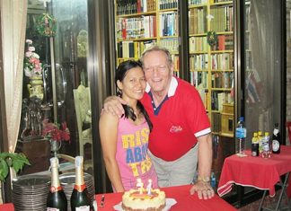 Lorena Paso (left) presents Max Rommel with a lovely birthday cake in commemoration of his birthday recently. Friends from the Rotary Club of Jomtien-Pattaya attended the celebrations to wish him many happy returns.