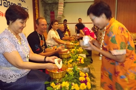 (L to R) Sopin Thappajug, Lewis Woody Underwood, Nittaya Patimasongkroh, Bernie Tuppin and Elfi Seitz have lustral water poured on their hands at the Songkran festivities at the Diana Garden Resort.