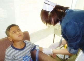 The youngest boy at the Children's Home was not too happy with his nurse.
