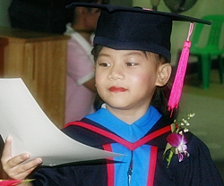 One of the many youngsters who received their graduation certificates.