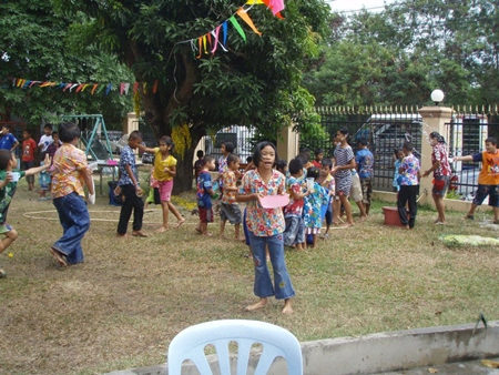 After the celebrations, the children have fun throwing water all over each other.