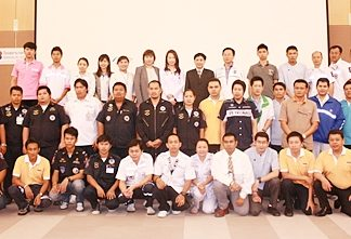 Trainees and trainers pose for a first day photo.