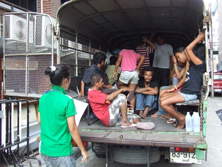 Officials load up some of Pattaya's vagrants to ship them off to the Ban Tabkwang shelter in Saraburi.
