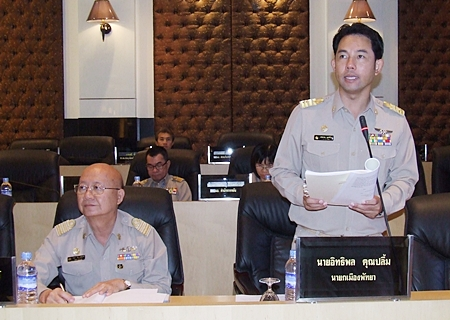 Mayor Itthiphol Kunplome (standing) addresses the Pattaya City Council.
