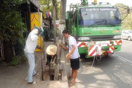 Pattaya Engineering Department workers clear storm drains along Second Road.