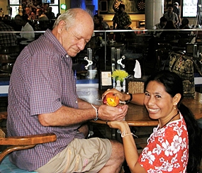 A tender moment as member Richard LeCavalier receives Songkran blessing from his lovely Thai wife, Phap.