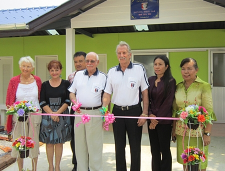 Benefactors and guests cut the ribbon to officially open the new facilities.