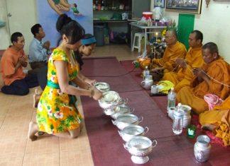 Sukanya Seaton, president of Seaton Foundation Pattaya, serves rice to monks.