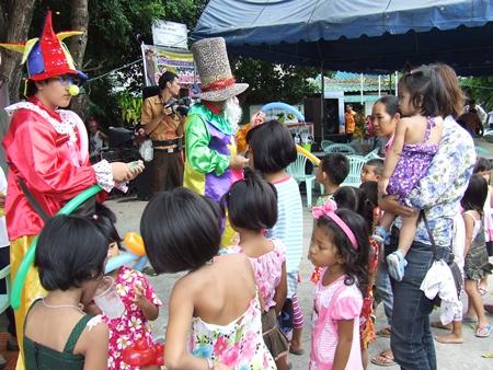 Children enjoy the custom made balloons.