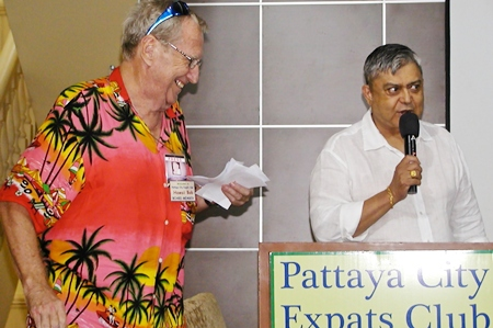 Open Forum MC Al Serrato prepares to hand the mike to Frugal Freddy CEO, 'Hawaii' Bob Sutterfield, for this week's drawing of gift certificates from some of Pattaya's better value restaurants.