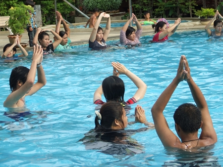 Expecting mothers and their families take part in hydrotherapy exercises at the Diana Garden Resort pool.