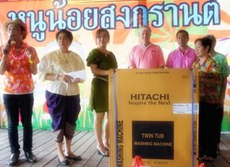 Floating Market management donates a washing machine to the Banglamung Home for the Elderly.