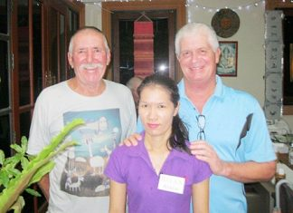 Bob Neylon and Ted Gardner with a staff member from The Relax Bar.