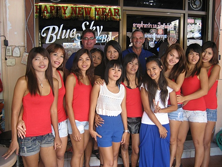 Andy Oz and Tony Cowe (standing rear) pose with the staff outside Blue Sky Bar.