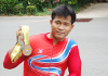 Supachai Koysub shows a selection of his winning medals from previous Olympic Games.