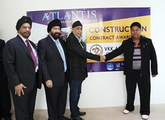 (Left-right) Directors of Blue Sky Development, Tripatpal Singh Sachdev, Popinder Singh Khanijou and Thawatchai Chawala shake hands with Worachai Pakdeesena, Director of VKK Architect, after the contract for construction of the Atlantis Condo Resort was signed on April 26.