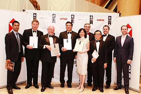 Representatives of CBRE Thailand led by David Simister, 3rd left, are presented with the awards April 27 at the JW Marriott Hotel in Kuala Lumpur, Malaysia.