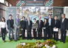 Suwat Iamwongwarn, Executive Director of Winsome Co., Ltd (5th from left), poses for a photo with Phanom Kanjanathiemthao, Managing Director Frank Knight Thailand (3rd from right) and other company executives at the launch of the Summer Garden condominium in Bangkok.