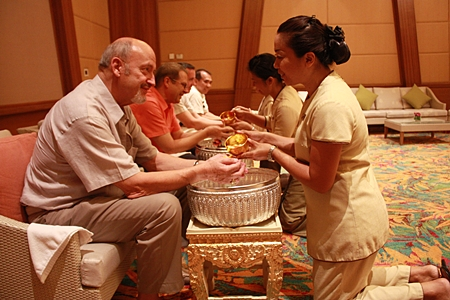 Staff of the Centara Grand Mirage Beach Resort Pattaya organised a 'Rod Nam Dum Hua' ceremony in the Thai traditional manner as a mark of respect, while seeking the blessings from the hotel's top management. Attending the ceremonies were Gerd Steeb, former President of Centara Hotels & Resorts, Andre Brulhart, the hotel's GM, and Executive Assistant Managers Paulo Matos and Wuthisak Pichayagan.
