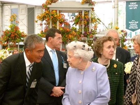 Her Majesty Queen Elizabeth II visits the gold medal winning Thai exhibit during the 2012 Chelsea Flower Show.