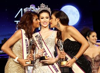 Miss Tiffany Universe 2012 Panwilas Mongkol (center) receives a congratulatory peck on the cheek from first runner up Nisha Chaiyapruek (left) and second runner up Siriworakorn Buttayothi (right) at the end of the 2012 Miss Tiffany Universe contest on May 4.