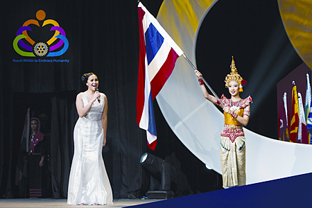 """Tata Young performs the National Anthem of Thailand at the opening plenary session during the RI Convention, May 6, in Bangkok.  Thailand hosted over 35,000 Rotarians from across the world in what is sometimes described as a """"mini United Nations"""" because of its internationality and multiculturalism."""