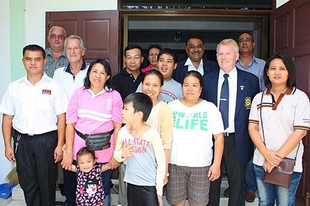 Members of the Pattaya Relief Group together with volunteers and their children at the center are all smiles during the official handover. (l-r) Samran Naepong (ESC) Steve Graham (MD ESC), William Macey (PSC), Pol. Lt. Col. Preecha Samrit, (5th left), Peter Malhotra (4th right), Gudmund Eiksund, (3rd right) President Rotary Club of Jomtien-Pattaya, Korn Kitja-amorn (2nd right) and Supang Samrit (right) director of the ALSC.