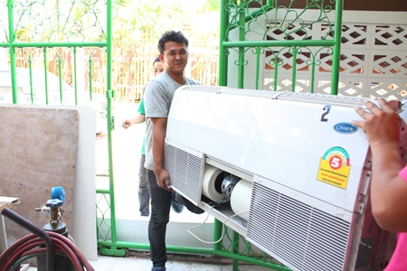 A happy day for all when the new air con arrives.