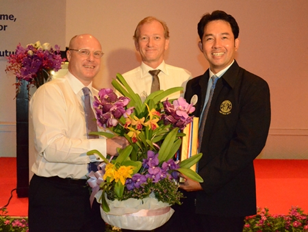(L to R) David Cumming, general manager Amari Orchid Pattaya, and Simon Landy, chairman of the British Chamber of Commerce Thailand, present Mayor Itthiphol Kunplome with a gift of appreciation for taking time to address the chambers.